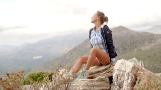 Fit Woman Resting at Top of The Rock in Spanish Mountains, Slow Motion Video