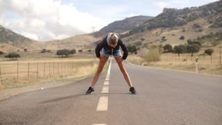 Fitness Lady Doing Stretch ups Before Run, Spanish Mountains on Slow Motion Video