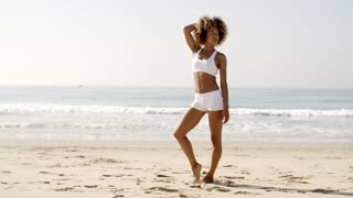 Fitness Young Woman Standing On Beach