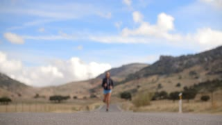 Fitress Girl Running on the Road in Mountains on Slow Motion Video
