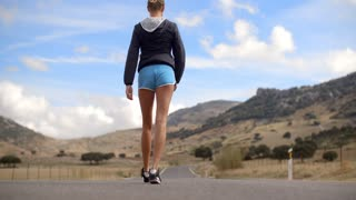 Fitress Girl Walking on the Road in Mountains on Slow Motion Video