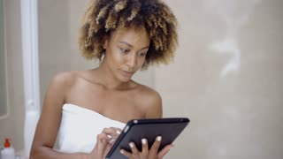 Girl In Bath Towels Using Touchpad