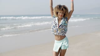 Girl Jumping With Joy On The Seashore