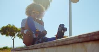 Girl Puting Her Roller Skates