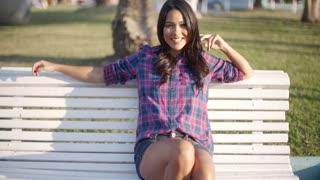 Girl Relaxing On Bench In Park