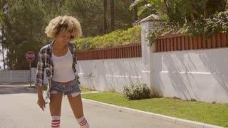 Girl Skates On Roller Skates.