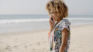 Girl Talking At Mobile Phone On The Beach