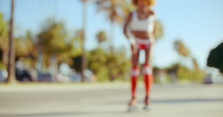 Girl Trying to Do Some Moves on Roller Skates