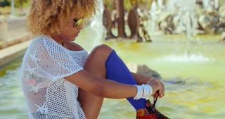 Girl Tying Shoelaces in Her Roller Skates