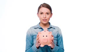 Girl With Her Piggy Bank Posing Isolated on White