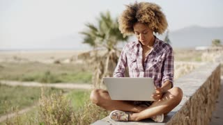 Girl Working With A Laptop Outdoors