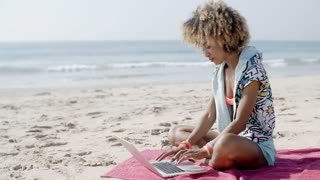 Girl Working With Laptop On The Sand Beach