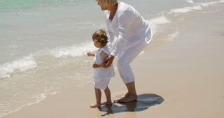 Grandma and Little Girl Having Fun at the Beach