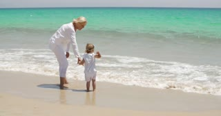 Grandmother and Little Girl Enjoying at the Beach
