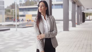 Grinning optimistic business woman