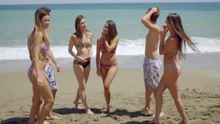 Group of Friends Standing Together on Sunny Beach