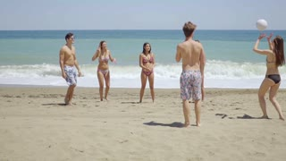 Group of young friends having fun on a beach