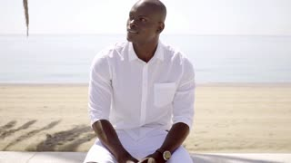 Handsome black model wearing white shirt