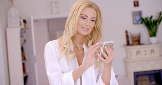 Happy Blond Woman Browsing at her Mobile Phone