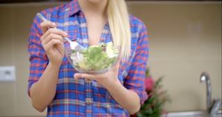 Happy Blond Woman Eating Healthy Vegetable Salad