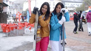 Happy female friends at a winter ski resort