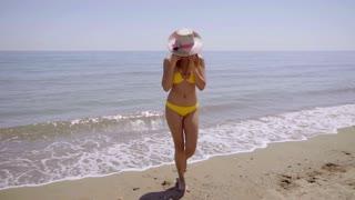 Happy gorgeous sexy woman in a bikini