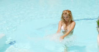 Happy Woman Enjoying in the Swimming Pool