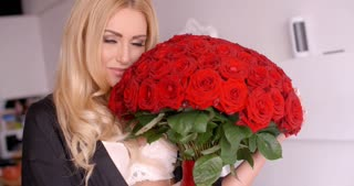 Happy Woman with Fresh Red Rose Flower Bouquet