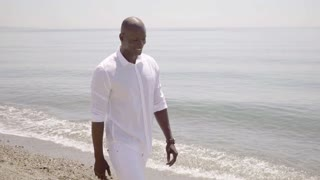 Healthy trendy young African man at the beach