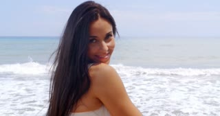 Hispanic Young Lady in White Enjoying at the Beach