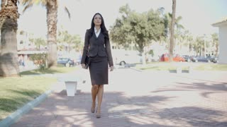 Lady In A Suit Walking Down The Street