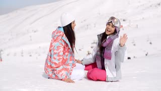 Laughing vivacious young women in snow
