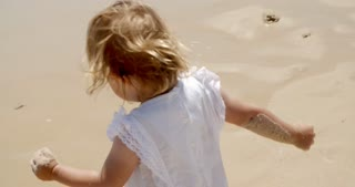 Little Blond Girl Enjoying at the Beach on Summer