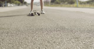 Longboard on the Ground In Front of a Skater Man