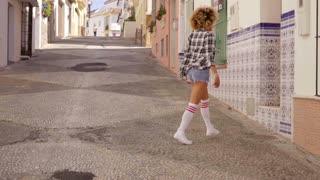 Model Walks The Mediterranean Street Along