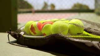 Number of tennis balls on a racket for training