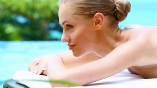 Portrait of beautiful woman on spa bed