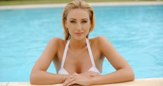 Pretty Blond Woman Leaning at the Poolside