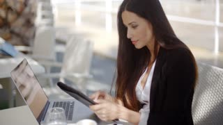 Pretty businesswoman working on a tablet