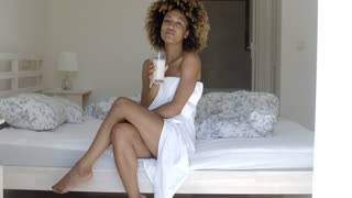 Pretty Girl Drinking Milk On The Bed