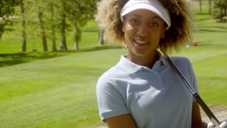 Pretty young African American golfer