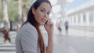 Relaxed young woman talking on her mobile