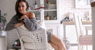 Seductive Woman Sitting on a White Chair
