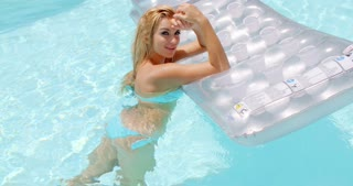 Seductive Woman With Floating Mattress in the Pool