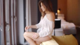 Sensual Beautiful Girl in Her Living Room