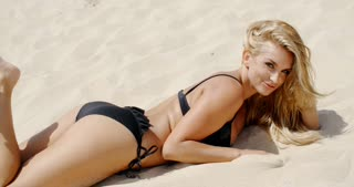 Sensual Blond Woman Lying on the Beach