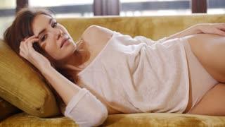 Sensual Girl Lying on Sofa at Her Home