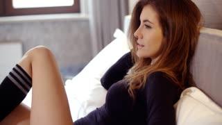 Sensual Girl Relaxing in Her Bedroom