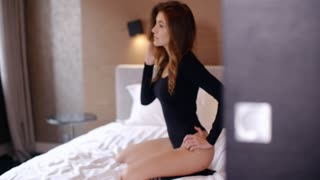 Sensual Woman Kneeing on Bed