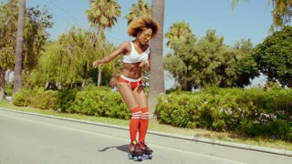 Sexy Afro American Girl in Shorts on Roller Skates